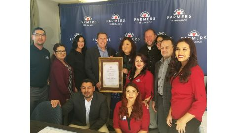 Nancy Tong & Senator Wilk, are surrounded by her employees and Farmers Insurance representatives who were on hand to celebrate her award
