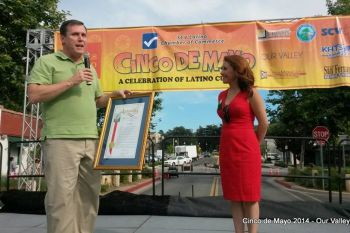 Presenting an Assembly Resolution to Patsy Ayala in honor of her recent United State Citizenship