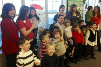 Scott with the staff and students at KinderCare Valencia