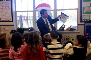 Scott reads a holiday story to Ms. Torres class