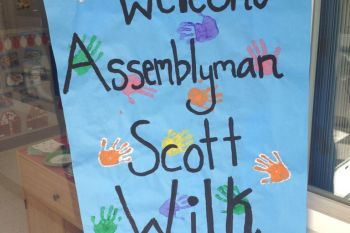 A sign made by the students at KinderCare Valencia greets Scott