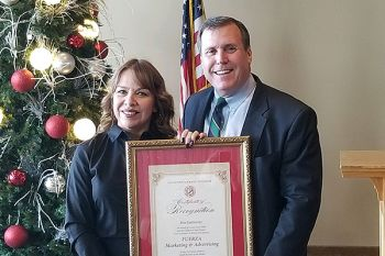 Senator Wilk honors Iris Gutierrez, owner of FUERZA Marketing and Advertising as the Small Business of the Month