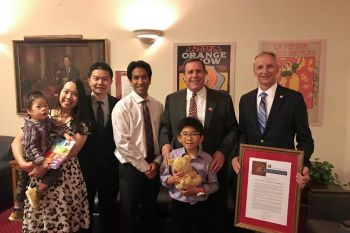 Timothy Zhang (baby) with parents Richard and Grace, Rodney Dong, PWCF Board of Directors, Senator Wilk, Kiran Dong and Roger Goatcher, PWCF Board of Directors President